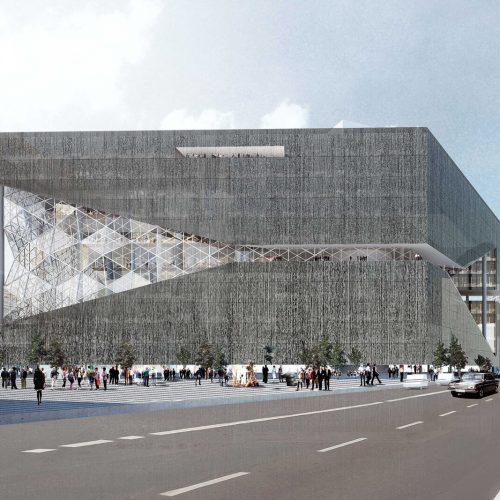 Der lichtdurchflutete Bau in Kubusform wird von einem Atrium geprägt. Getönte Glasflächen und Bauelemente in 3D-Optik bilden die Fassade. Foto: Axel Springer